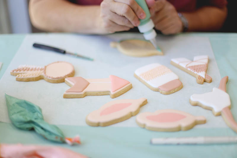 students decorating cookies during a cookie decorating class in Irvine, CA