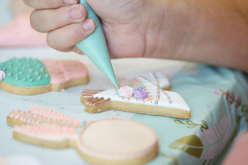 piping on decorated cookie