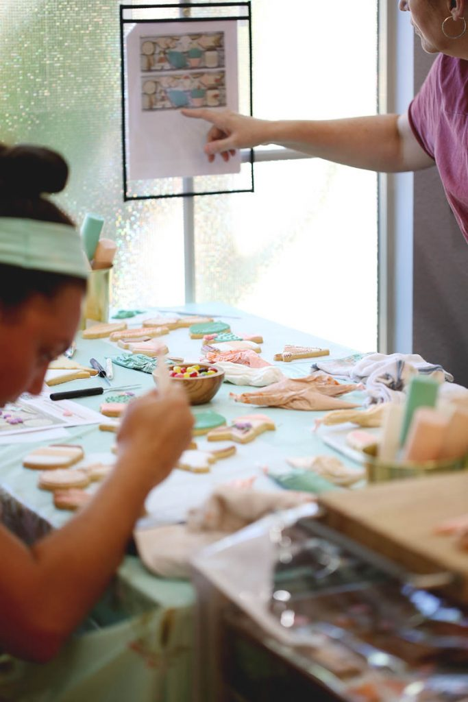 students learning how to decorate cookies