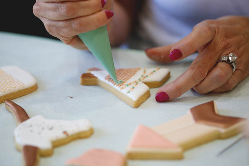 student learning how to decorate cookies