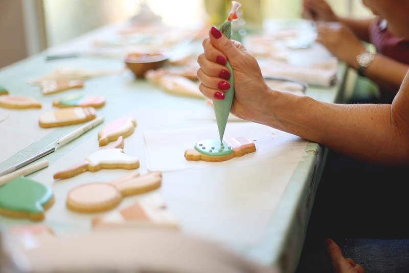 student decorating cookies