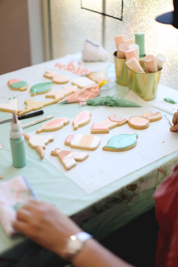 student decorating cookies