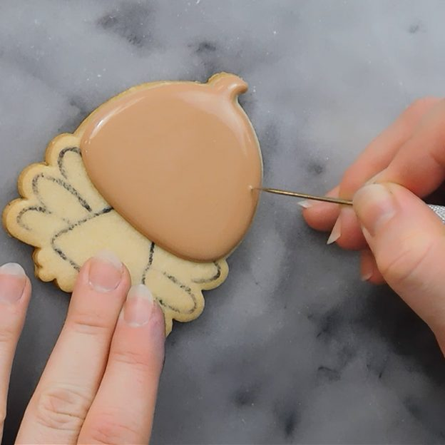 screen shot of decorating a turkey cookie from online Thanksgiving cookie decorating video